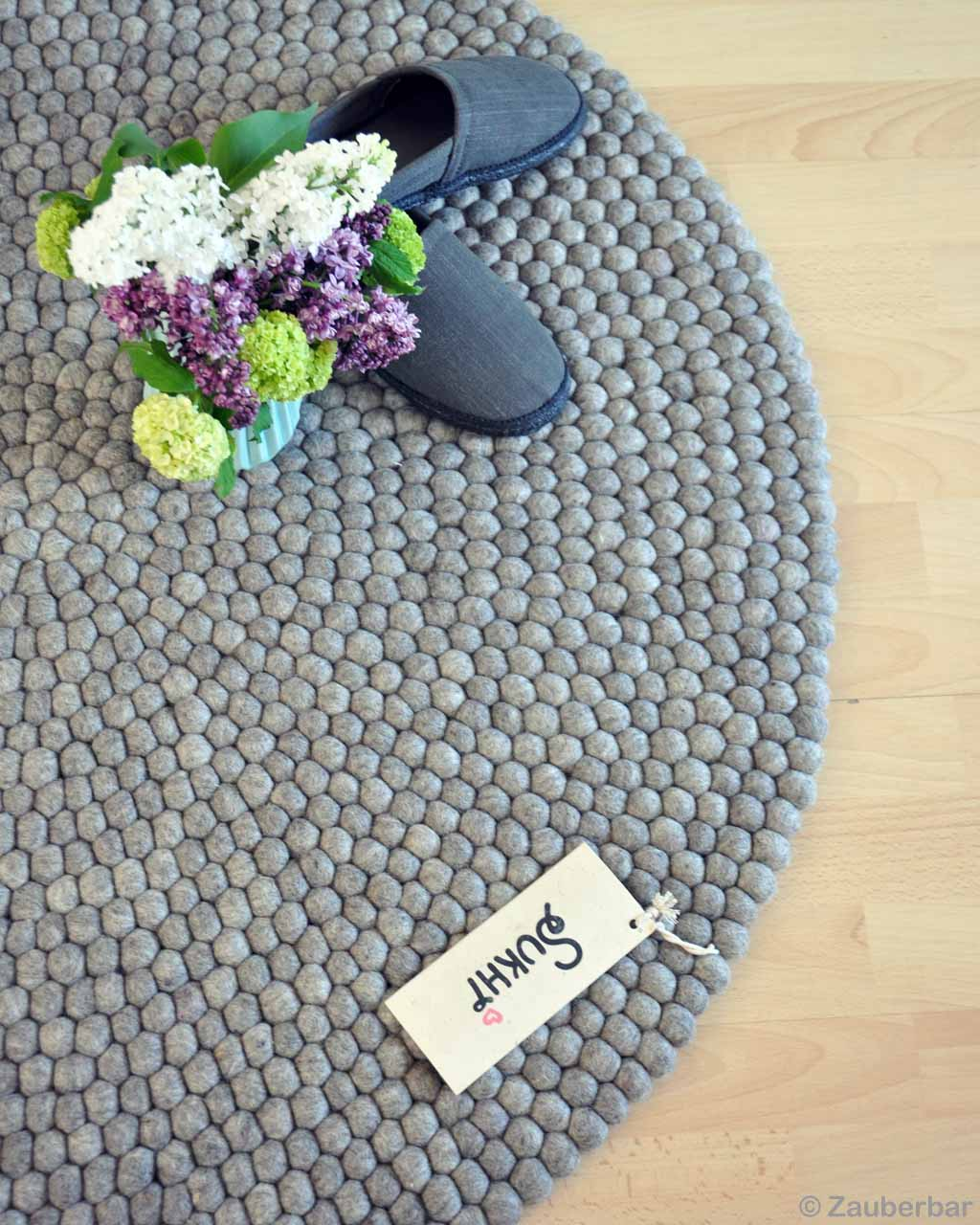 handmade gray shoes and bunch of flowers modern rectangular rug