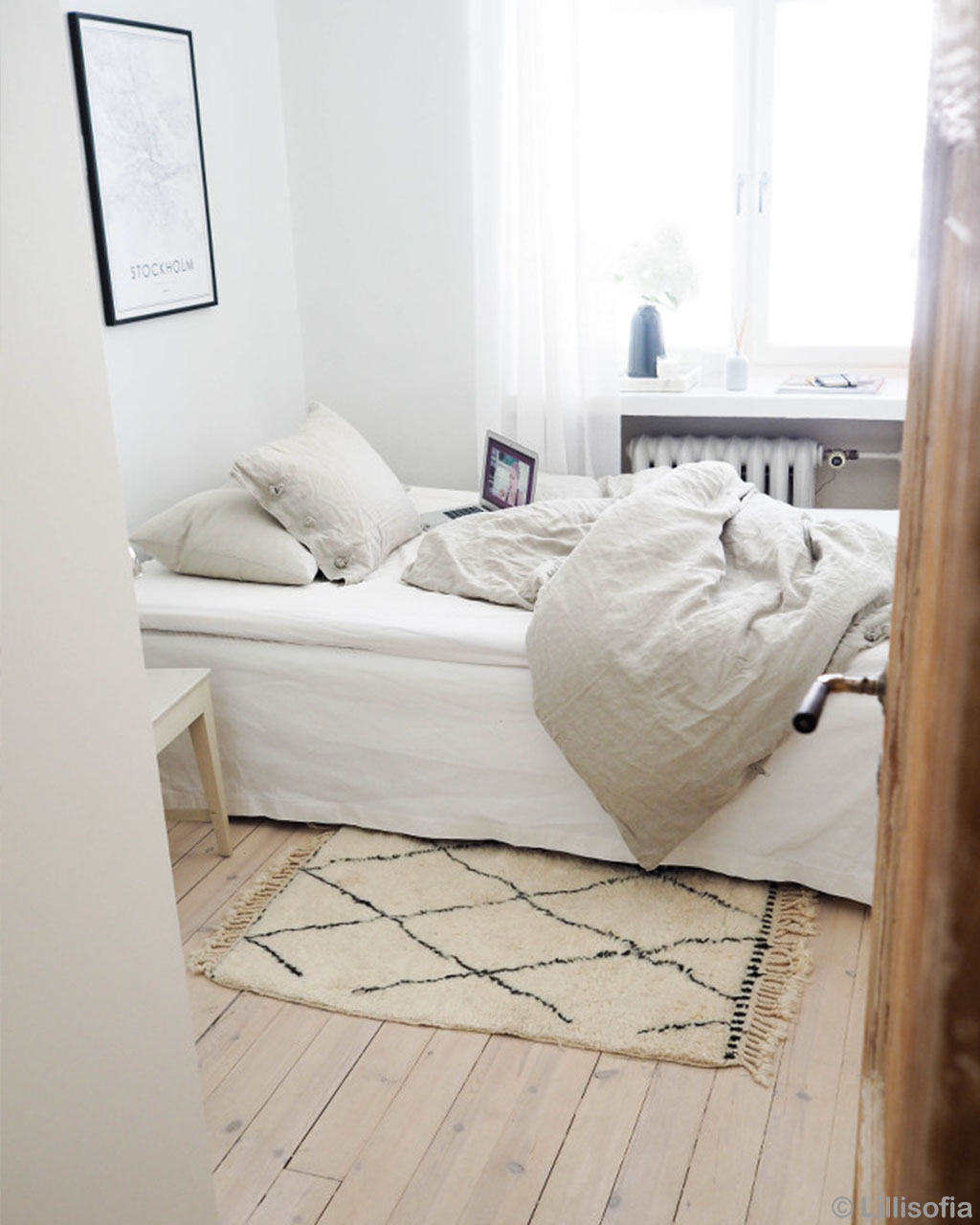laptop on white bed from morocco modern rugs