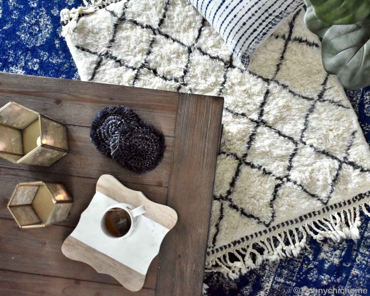 multiple decoration items on wooden table made by moroccan rugs