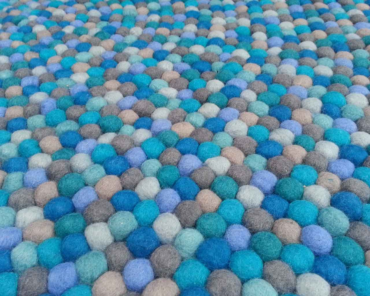 nepalian made designer blue cyan white and gray felt ball fluffy rugs