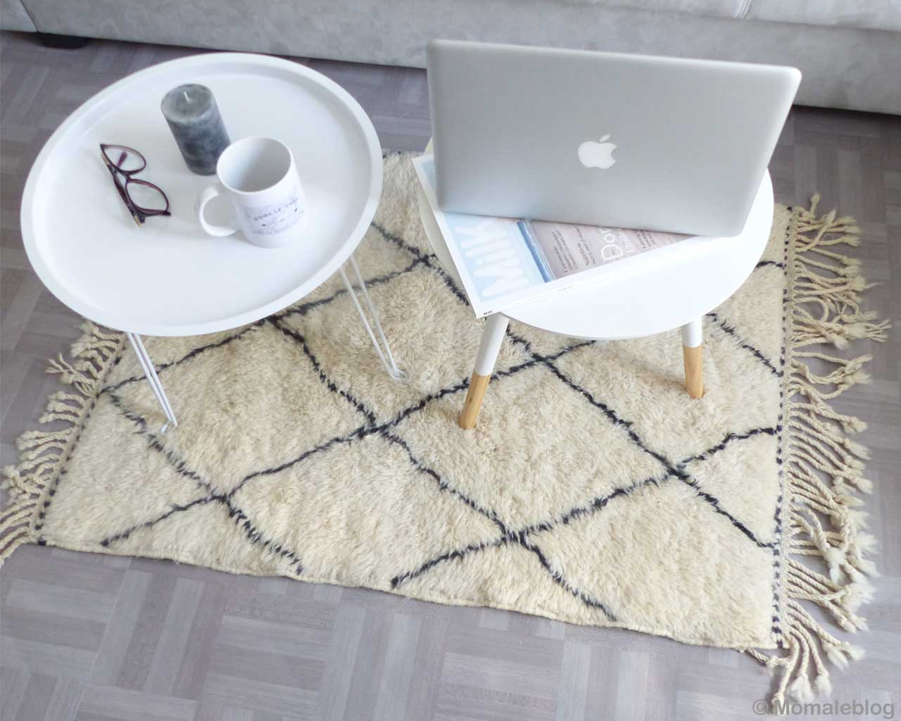 round table with gray laptop moroccan modern accent rug