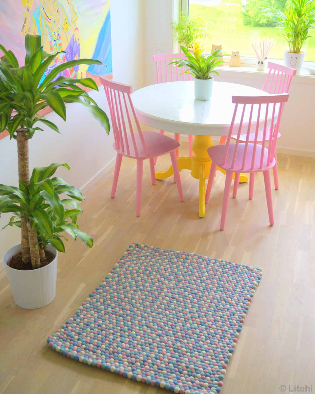 sweet round white table with pink chairs nepalian made traditional rugs