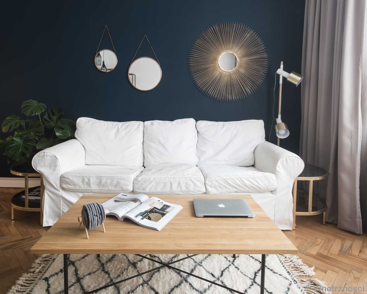 white sofa and brown center table african oriental rugs